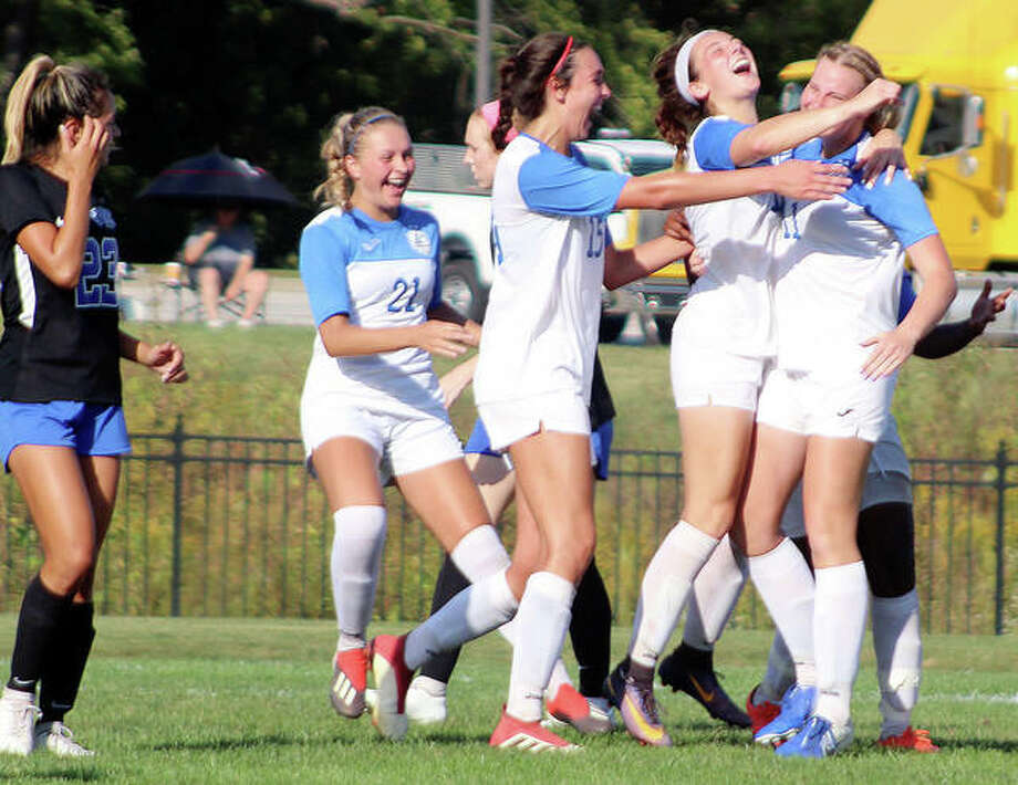 Lauren Martee of Southwestern Illinois, far left, watches as Lewis and Clark players Emma Lucas 921), Carly Smith (15) Cassie Hall and Candice Parziani, far right celebrate Parziani's golden goal early in overtime that lifted No. 8-ranked LCCC to a 1-0 win over No. 20 SWIC Wednesday at Tim Rooney Field. Photo: Pete Hayes | The Telegraph
