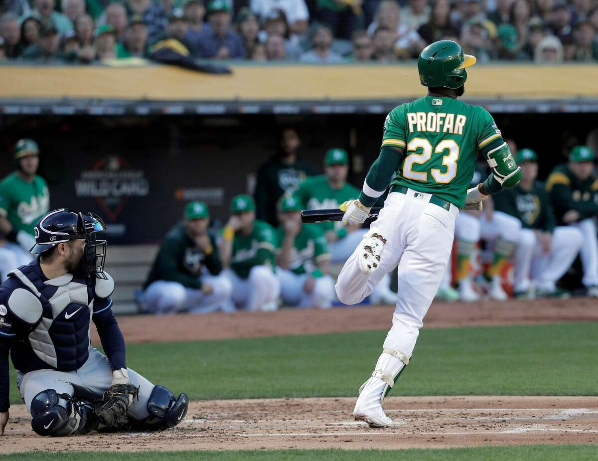Jurickson Profar (23) hops after avoiding getting hit by a pitch in the first as the Oakland Athletics played the Tampa Bay Rays at the Oakland Coliseum in the AL Wild Card playoff game in Oakland, Calif., on Wednesday, October 2, 2019.