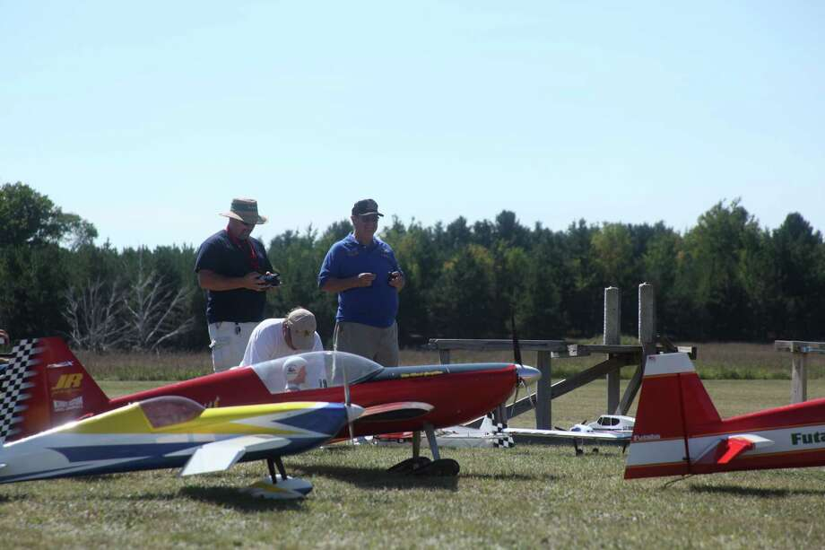 "MODEL CITIZENS: Model plane pilots fly planes known as ""40 percenters,"" which are designed to be 40 percent of the size of the plane they're modeled after. (Pioneer photos/Whitney Gronski-Buffa)"