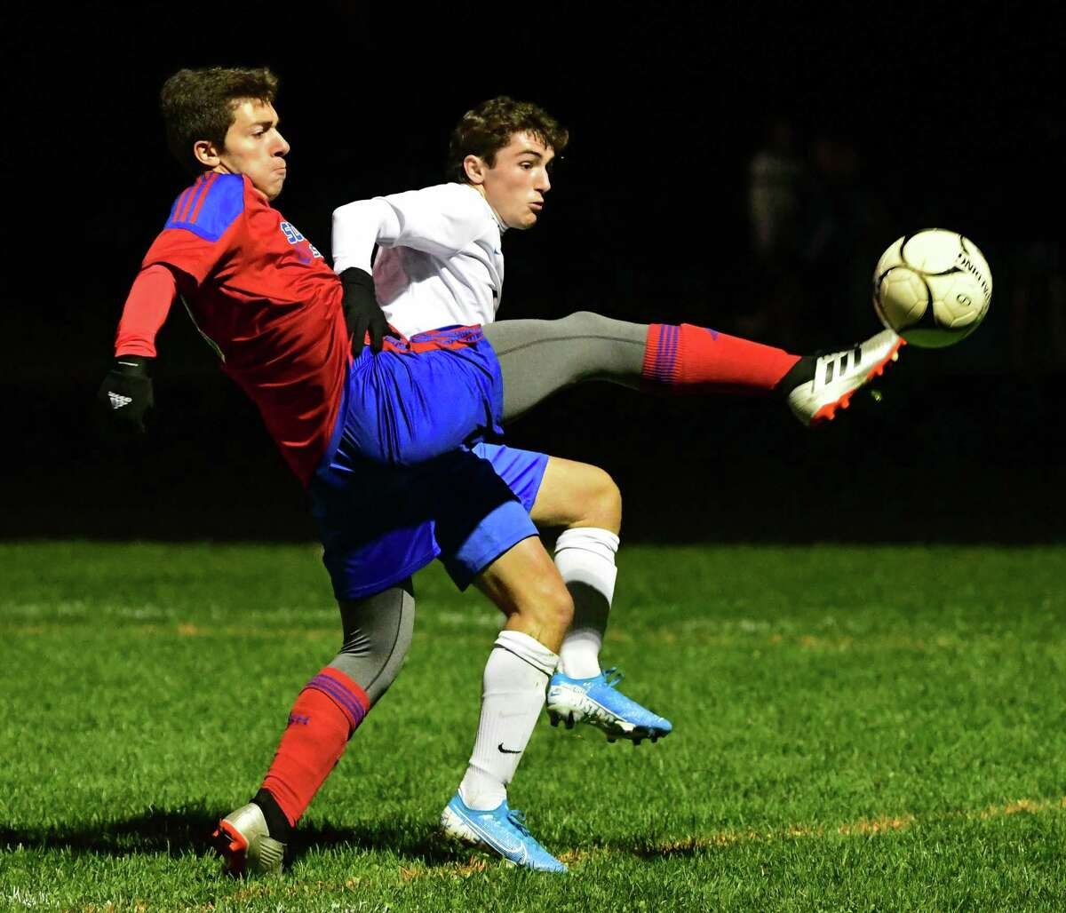South Glens Falls' Justin Nesbitt, left, battles for the ball with Queensbury's Teddy Borgos during a soccer game on Wednesday, Oct. 2, 2019. The Suburban Council schools won't be able to start their season before March 1. (Lori Van Buren/Times Union)