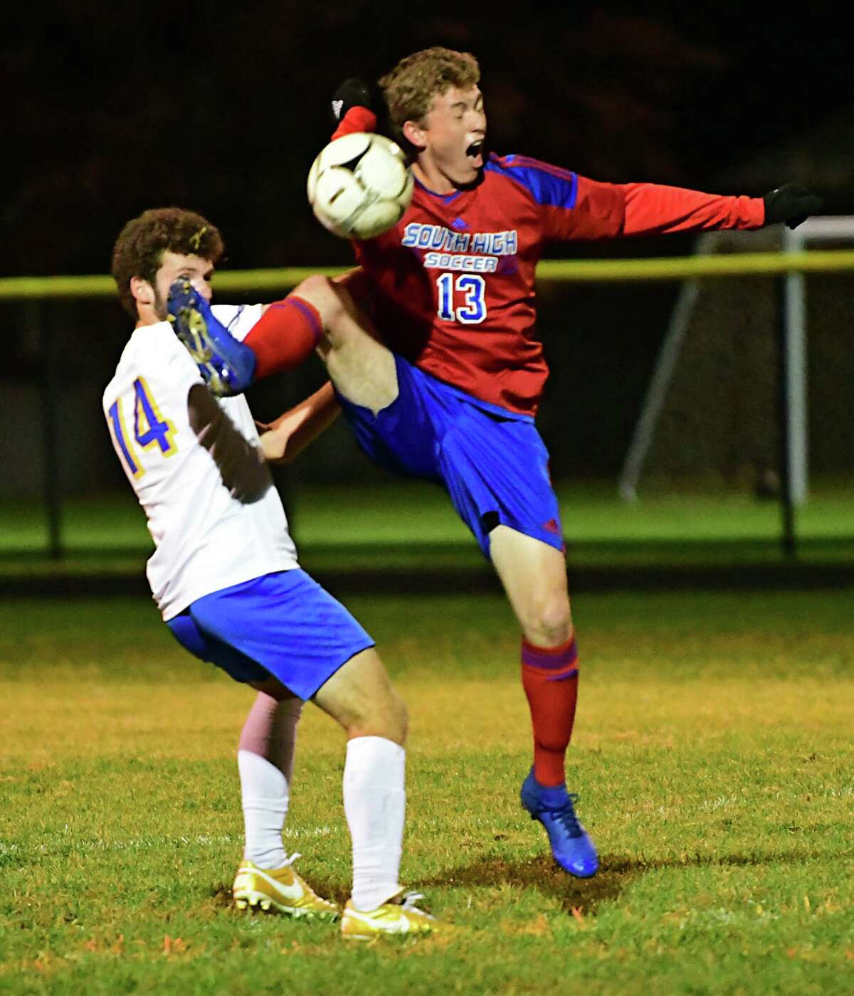 Queensbury's Lucas McCane, left, battles for the ball with South Glens Falls' Andrew King during a soccer game on Wednesday, Oct. 2, 2019. This school year's season has been pushed to spring. (Lori Van Buren/Times Union)