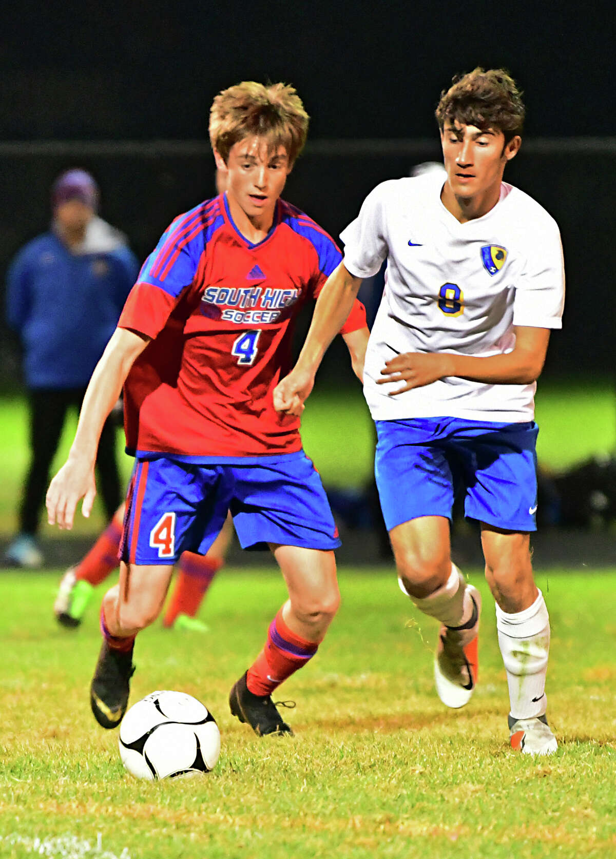 South Glens Falls' Bobby Bruschini, left, battles for the ball with Queensbury's Alejandro Garcia-Barrientos during a soccer game on Wednesday, Oct. 2, 2019 in South Glens Falls. This coming season won't happen until spring. (Lori Van Buren/Times Union)