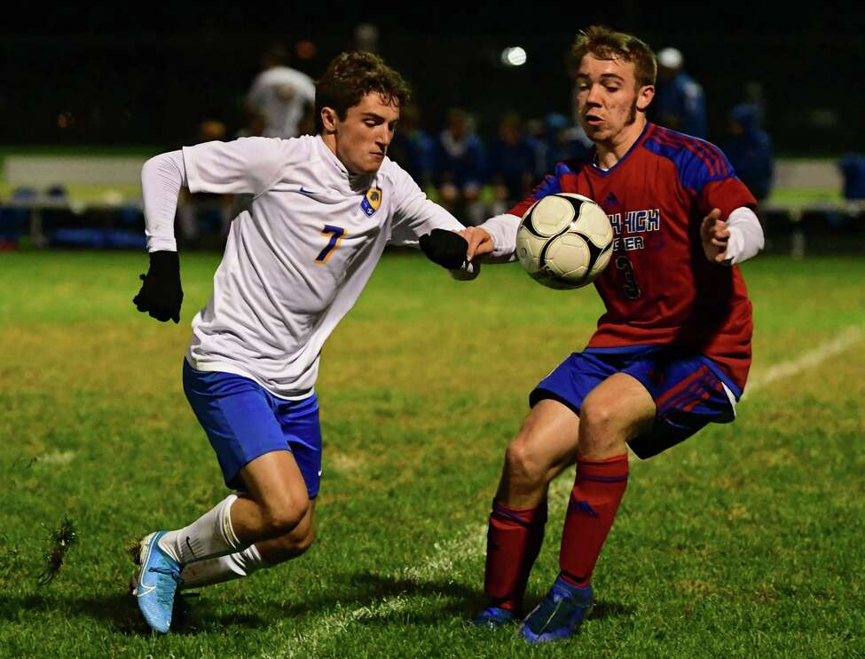 Queensbury's Teddy Borgos, left, battles for the ball with South Glens Falls' Derek Buhman during a soccer game on Wednesday, Oct. 2, 2019 in South Glens Falls, N.Y. (Lori Van Buren/Times Union)