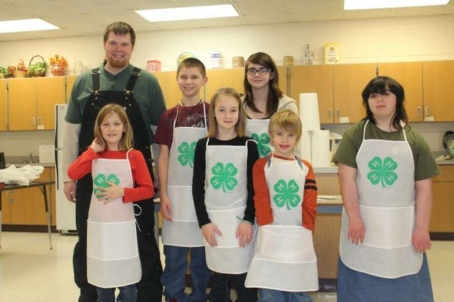COOKING AWARDS: Each 4-H club member who participated on Saturday during the Osceola County 4-H cook off received recognition for the dishes they prepared. Front from left: Gracie ward, Megan Ebels and Braden Ebels. Back from left: Osceola County 4-H Coordinator Jacob Stieg, Tanner Ryan and Jade Ebels all display their 4-H aprons they were awarded on Saturday. (Pioneer photo/Lonnie Allen)