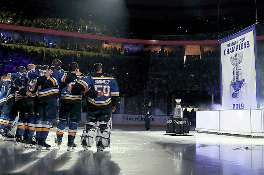 The Blues watch as the Stanley Cup championship banner is raised during a ceremony before the start of Tuesday night's season opener against Washington at Enterprise Center. Photo: AP Photo