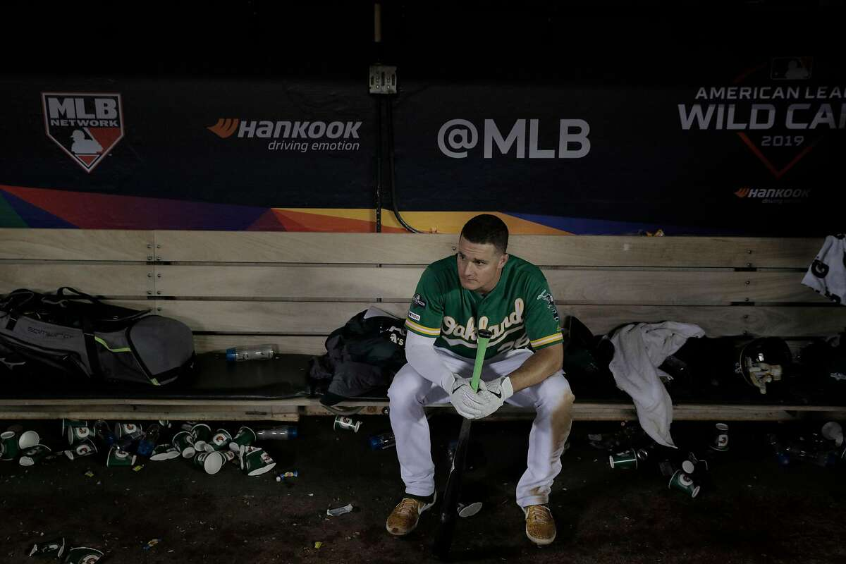 Matt Chapman (26) sits in the dugout after the Oakland Athletics were defeated by the Tampa Bay Rays at the Oakland Coliseum in the AL Wild Card playoff game in Oakland, Calif., on Wednesday, October 2, 2019. The Rays defeated the A's 5-1.