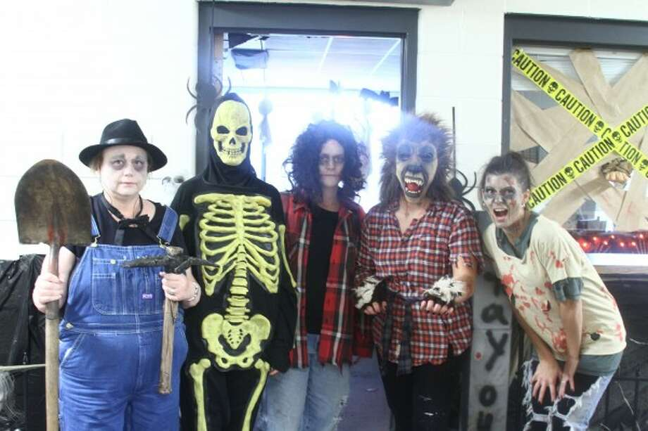FRIGHTFUL FUN: Staff from the Mecosta County Clerk's Office stand outside their door, ready to welcome guests into their haunted cemetery. (Pioneer photos/Emily Grove-Davis)