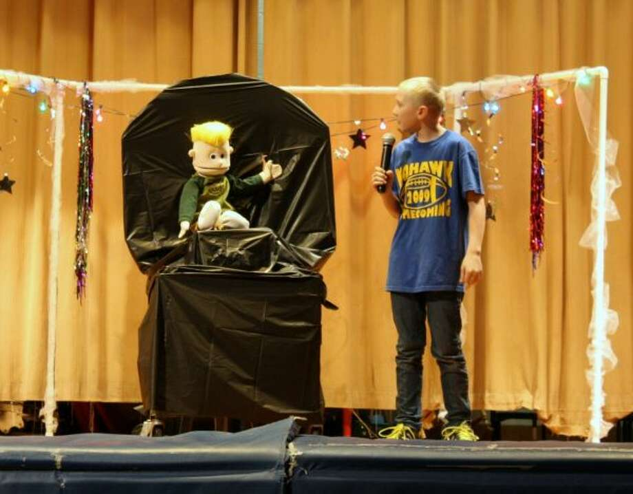 VENTRILOQUIST: Kayden Kangas and Bethany Moore (not visible) teamed up to create a comedy skit based on the interaction between Kangas and Andy, the ventriloquist dummy for the Morley Stanwood Elementary talent show. (Pioneer photo/Candy Allan)