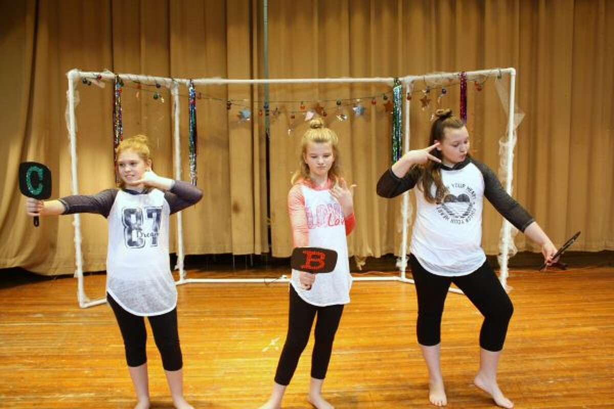 GIRL POWER: (From left) Cassie Cooley, Bryonna Larson and Lila Hoisington performed a dance number to