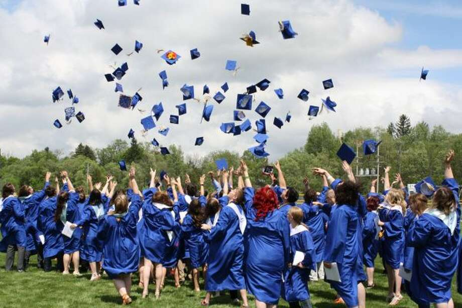 CELEBRATION: The newest alumni of Morley Stanwood High School toss their graduation caps in the air in celebration on Sunday. (Pioneer photo/Candy Allan)