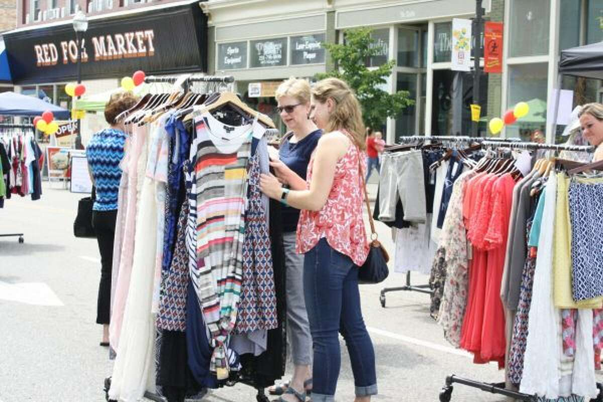 Carrie Franklund (left) and Emily Franklund (right) browse the racks outside Serendipity on Saturday. (Pioneer photo/Candy Allan)