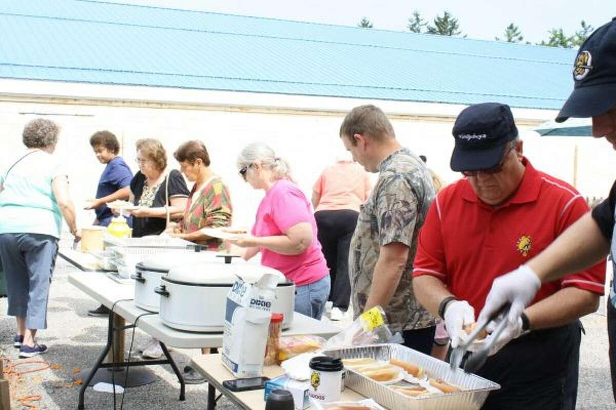 Community members line up to receive a free lunch during Big Rapids Beginnings on Saturday, courtesy of Elks Lodge No. 974. (Pioneer photo/Candy Allan)