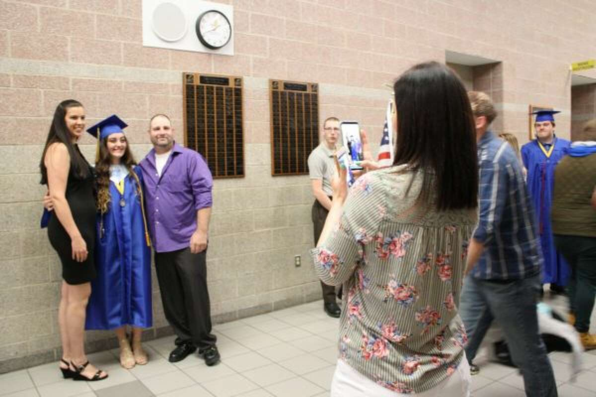 In the moments before the ceremony, graduates took time to pose for photos with family and friends. (Pioneer photo/Candy Allan)