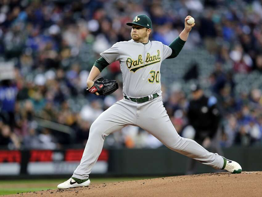 Oakland Athletics starting pitcher Brett Anderson works against the Seattle Mariners during the first inning of a baseball game, Saturday, Sept. 28, 2019, in Seattle. (AP Photo/John Froschauer)