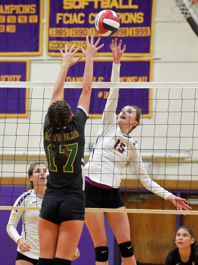 Westhill's Betsy Sachs (15) taps the ball past Trinity Catholic's Valeria Barbaglio (17) in an FCIAC girls volleyball match at Westhill High School on Oct. 2, 2019 in Stamford, Connecticut. Photo: Matthew Brown / Hearst Connecticut Media / Stamford Advocate