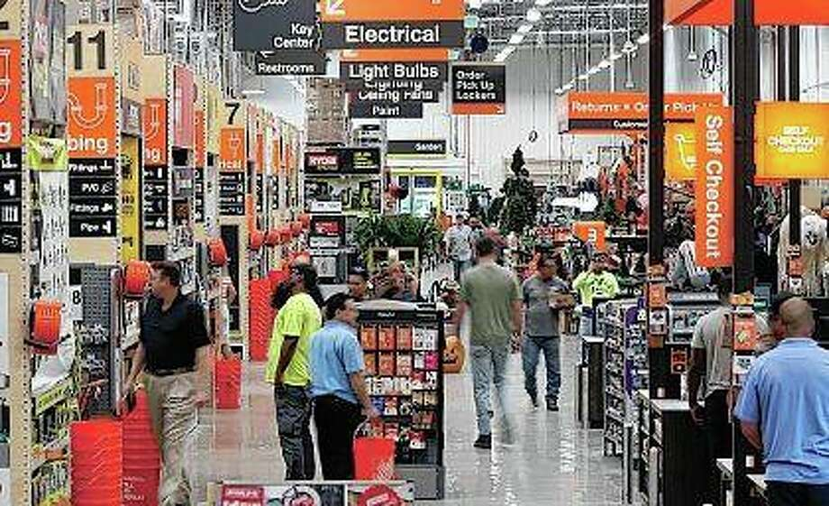 """Customers pass through the """"racetrack,"""" the busiest aisle that is by the registers. Home Depot is leading a charge of retailers looking for legislative help in dealing with organized retail crime. The thieves use all sorts of methods and in most cases, they know they will not be physically stopped. They make off with hundreds and sometimes thousands of dollars worth of goods. Photo: Bob Andres 
