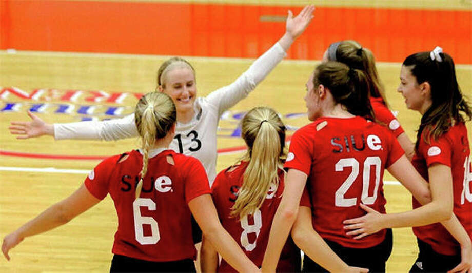 SIUE libero Jordyn Klein (13) celebrates with teammates during a three-set OVC sweep of Eastern Illinois on Wednesday night at First Community Arena in Edwardsville. Klein had a career-high 31 digs in the victory. Photo: The Telegraph