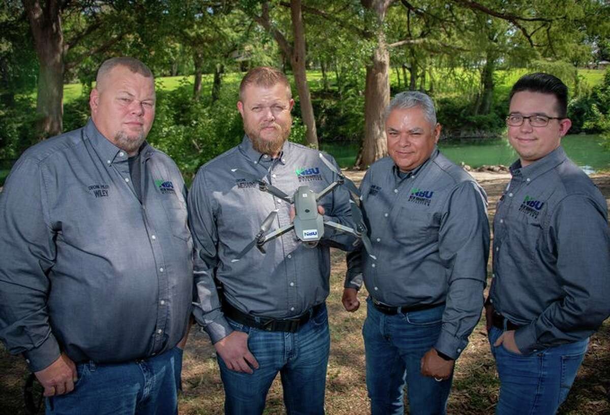 NBU's UAV operators show off the UAV, the newest tool NBU hopes will increase efficiency and reduce manpower when it comes to visual inspections of transformers, electrical lines and water towers.