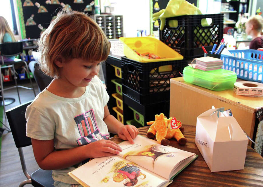 This week, Shannon Popham had her first grade students at Laker Elementary adopt Beanie Babies and as part of the adoption agreements, students must read to them for at least 20 minutes every day. Once all of the Beanie Babies were adopted, the class celebrated with cake. Photo: Courtesy Photo