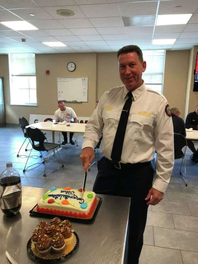 Deputy Fire Marshal John Kiernan is honored on his last day of work with the Greenwich Fire Department. Photo: / Greenwich Professional Firefighters Facebook Page