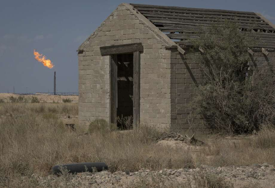 A flare burns near an abandoned building near Pecos. Photo: Jon Shapley/Staff Photographer