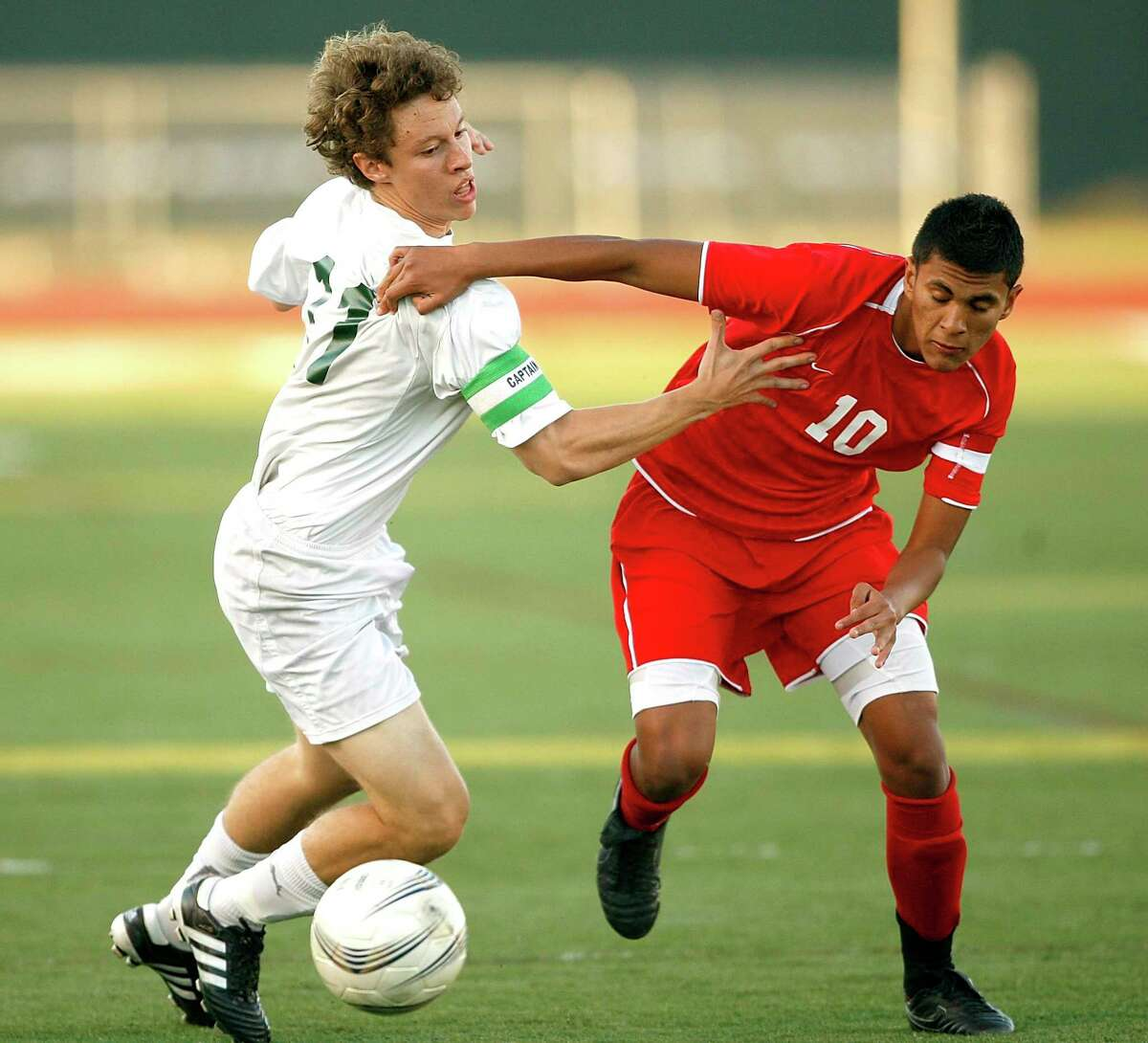Strake's James Garcia-Prats, left and Katy's Adrian Mendoza battle for the ball during third round of Class 5A soccer playoffs between Katy and Strake Jesuit Tuesday Mar. 30, 2010 in Houston.