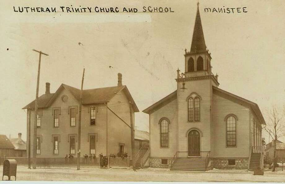 The Trinity Lutheran School and Church that was located on First Street in Manistee is shown in this photograph form the early 1900s.