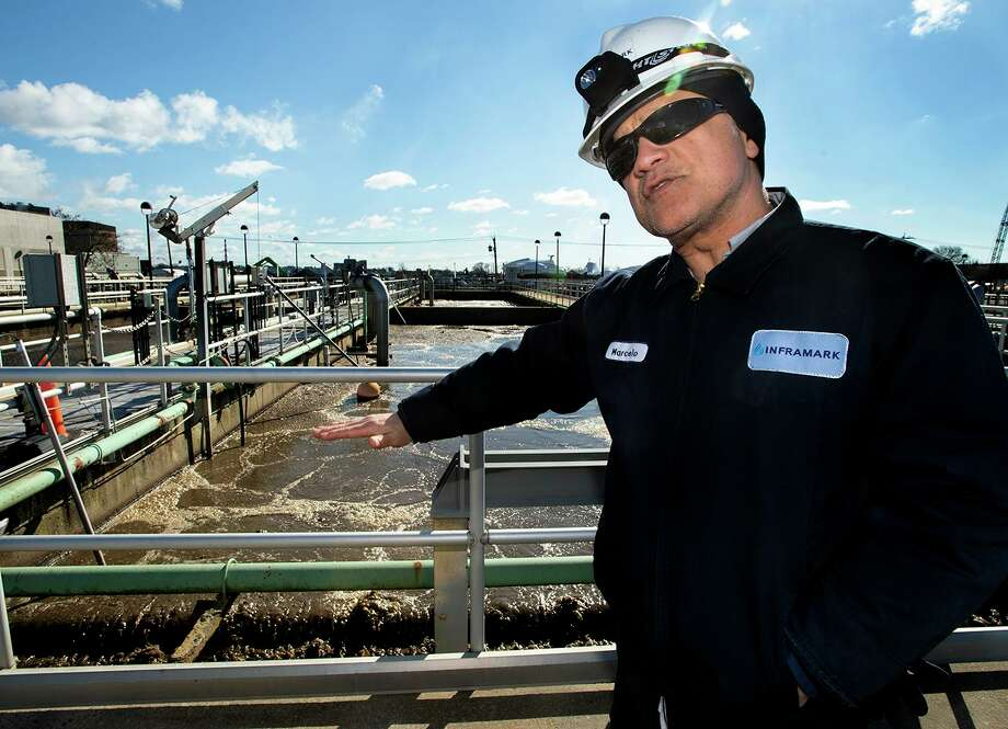 Marcelo Borges, the West Side water treatment plant supervisor, explains the plant's operations. Photo: Melanie Carol Stengel / C-Hit.org