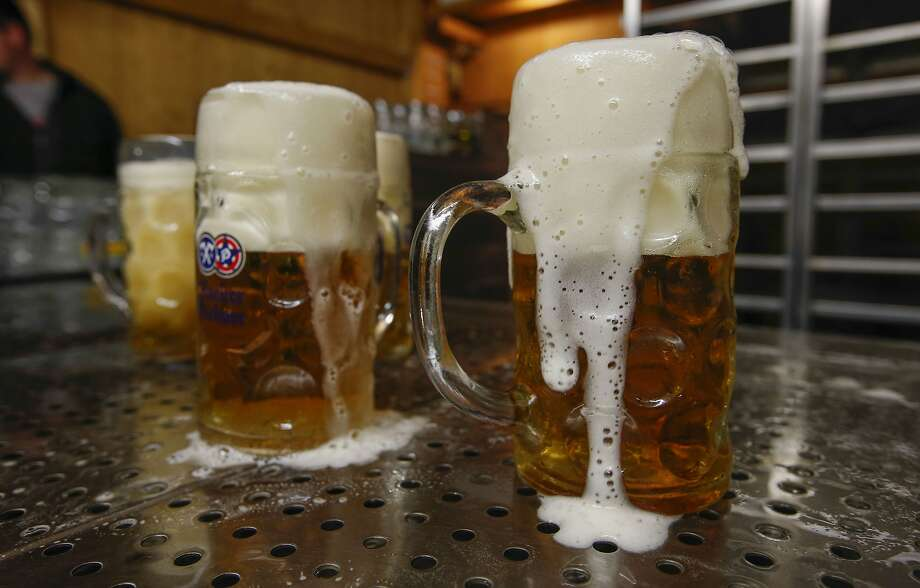 Pints of frothy Hacker-Pschorr beer sit on a bar drainage tray inside the Paulaner Brauerei GmbH 'Hackerzelt' beer tent at the Oktoberfest in Munich, Germany, on Thursday, Sept. 26, 2019. Almost 8 million liters, enough to fill more than three Olympic-sized swimming pools, flow from 28,000-liter tanks and into the bellies of roughly 6 million revelers at Munich's annual Oktoberfest. Photographer: Michaela Handrek-Rehle/Bloomberg Photo: Michaela Handrek-Rehle, Bloomberg