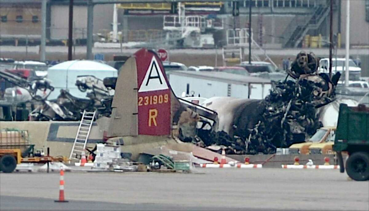 The tail section and part of the fuselage can bee seen of a vintage WWII aircraft that crashed while attempting to land at Bradley International Airport in Windsor Locks on Wednesday morning.