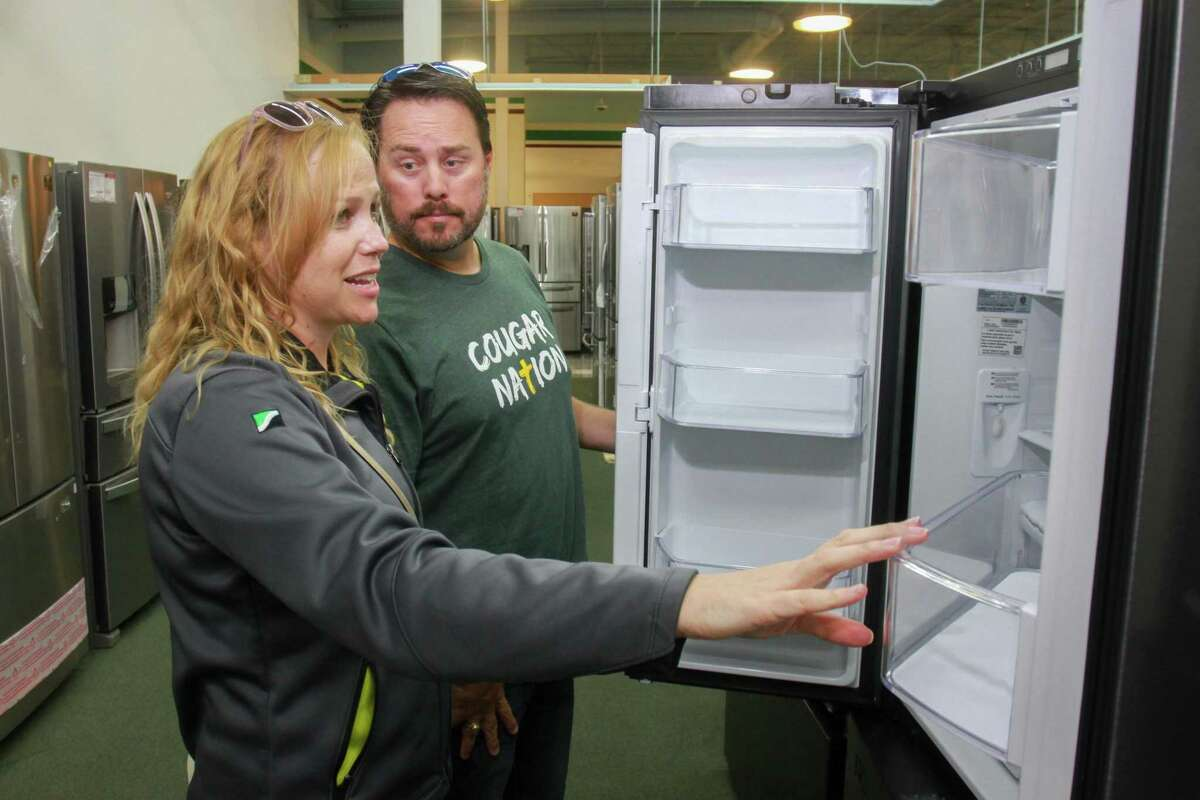 Dallas and Sarah Lusk shopping refrigerators at the first Best Buy Outlet store. The store offers open-box appliances, TVs and electronics at a discount of up to 60 percent, opened recently on Tomball Pkwy. September 27, 2019.