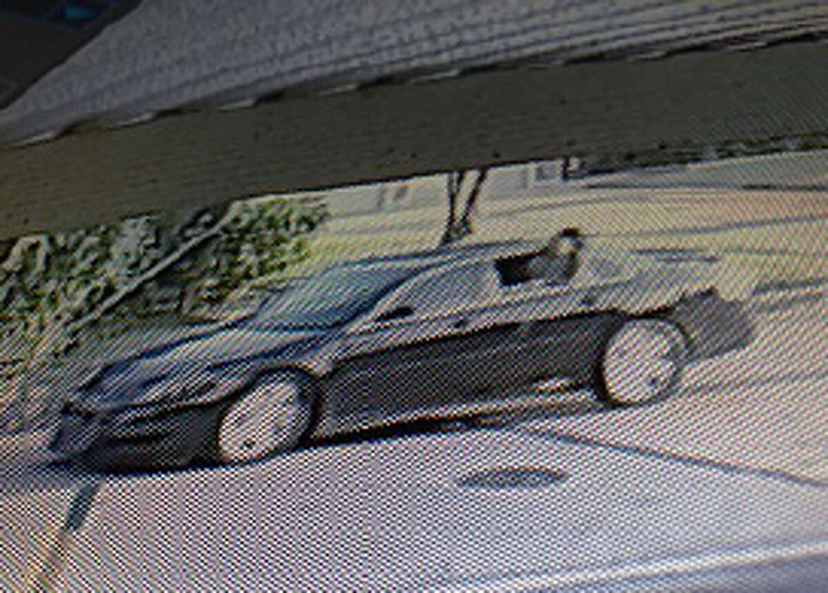 The vehicle is said to be a 2006-2013 black Chevrolet Impala with tinted windows, paper plates & a dark tint over the plates.
