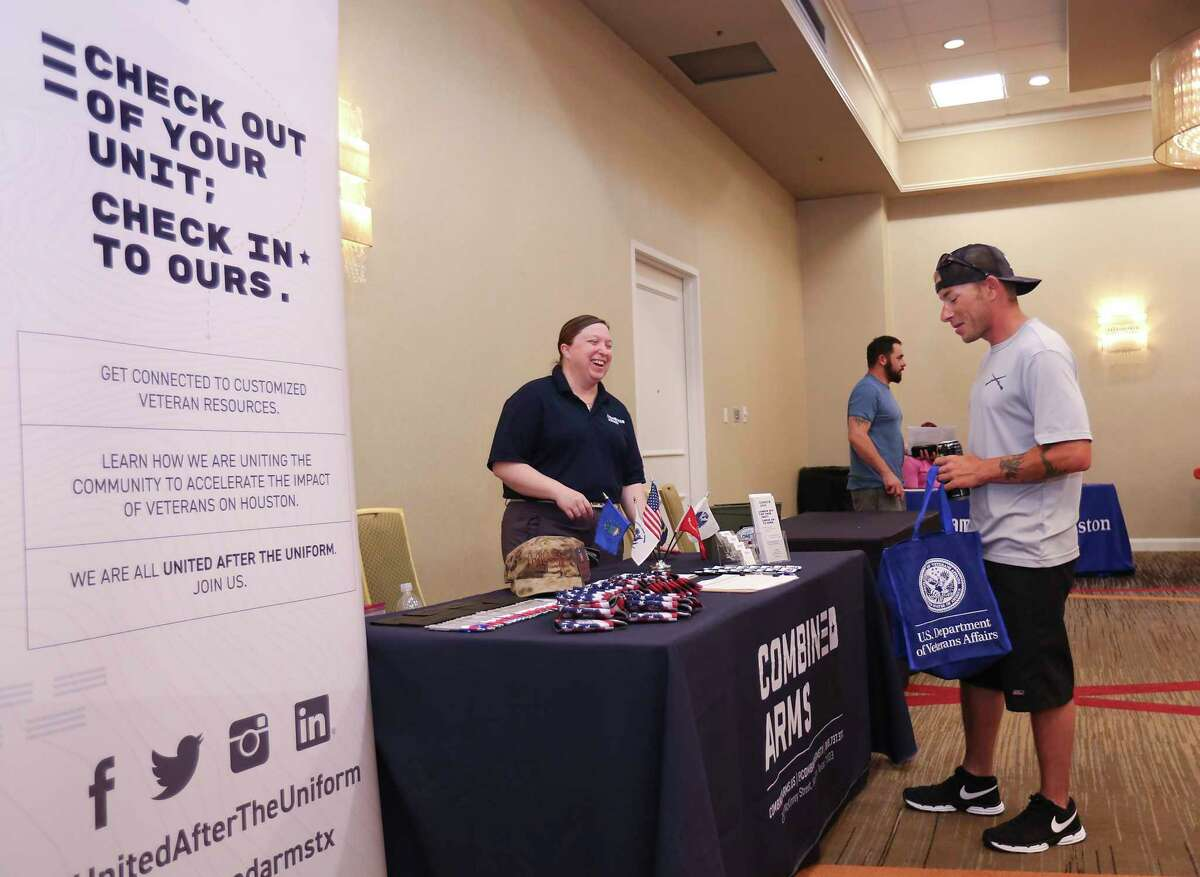 Michelle Cox with Combined Arms talks with Sgt. Lloyd Wharmon at the Resiliency Resource Fair at the Houston Marriott on May 11, 2019 in Houston, TX. This joint venture with the Department of Veterans Affairs, Operation Resiliency, addresses veteran suicide by reuniting military units with a high casualty rate at reunion retreats focused on suicide prevention. (Thomas B. Shea/For the Chronicle)