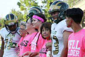 Marta Imelda Martinez (center) looks to her left before she and fellow breast cancer survivors and fighters were honored before a football game Oct. 7, 2018 between Cypress Falls and Cypress Springs high schools at Cy-Fair FCU Stadium.