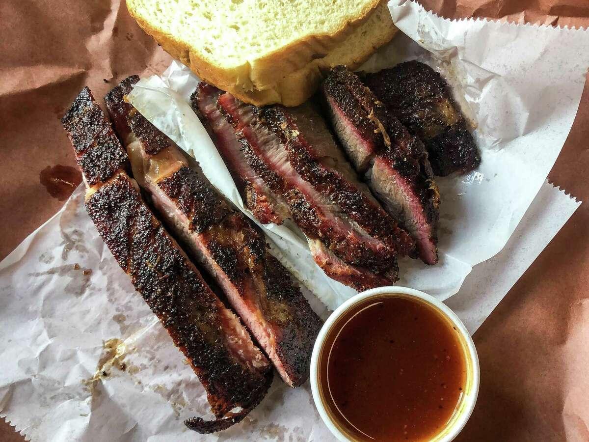 Pork ribs, left, and sliced pork steak at City Meat Market, Giddings, Texas.