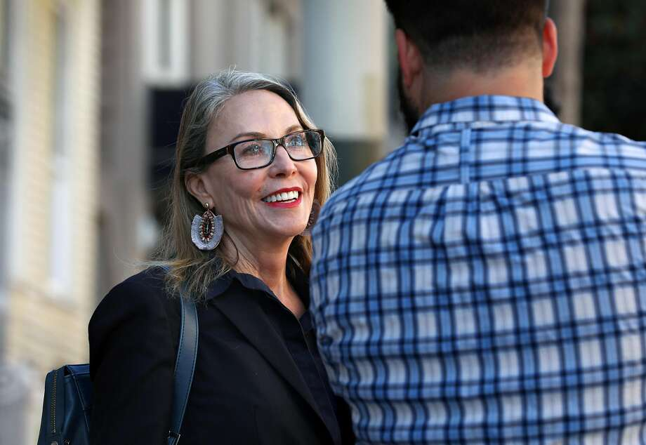 Supervisor Vallie Brown, candidate for District Five supervisor, campaigns at a bus stop at McAllister and Divisadero streets. Photo: Liz Hafalia / The Chronicle