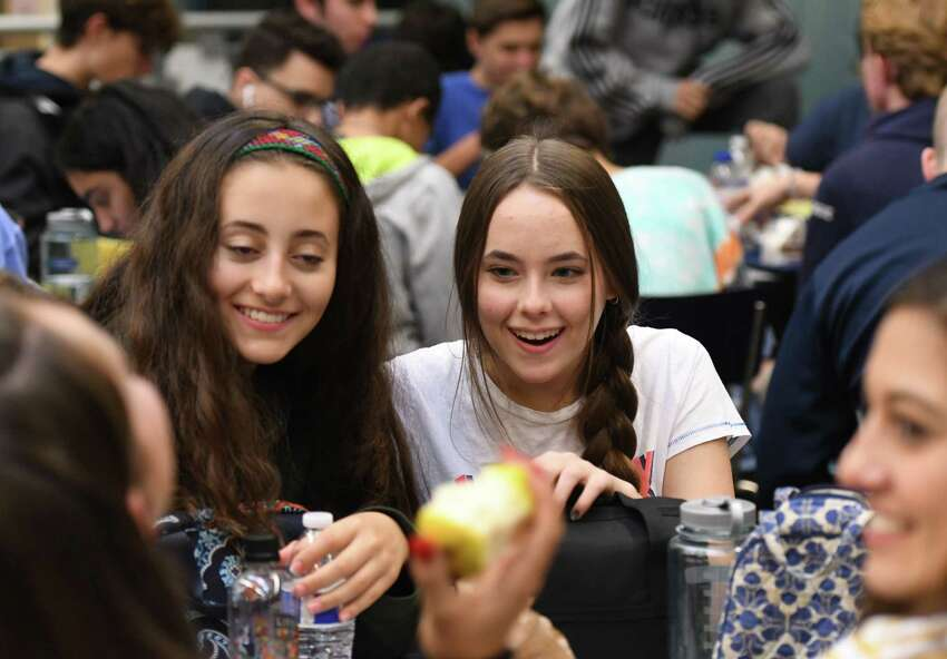 Rita Connolly, a sophomore at Saratoga Springs High School who is vegetarian, center, enjoys lunch with her friends on Thursday, Oct. 3, 2019, at the school cafeteria in Saratoga Springs, N.Y. The school offers daily vegan meal options for its students. (Will Waldron/Times Union)
