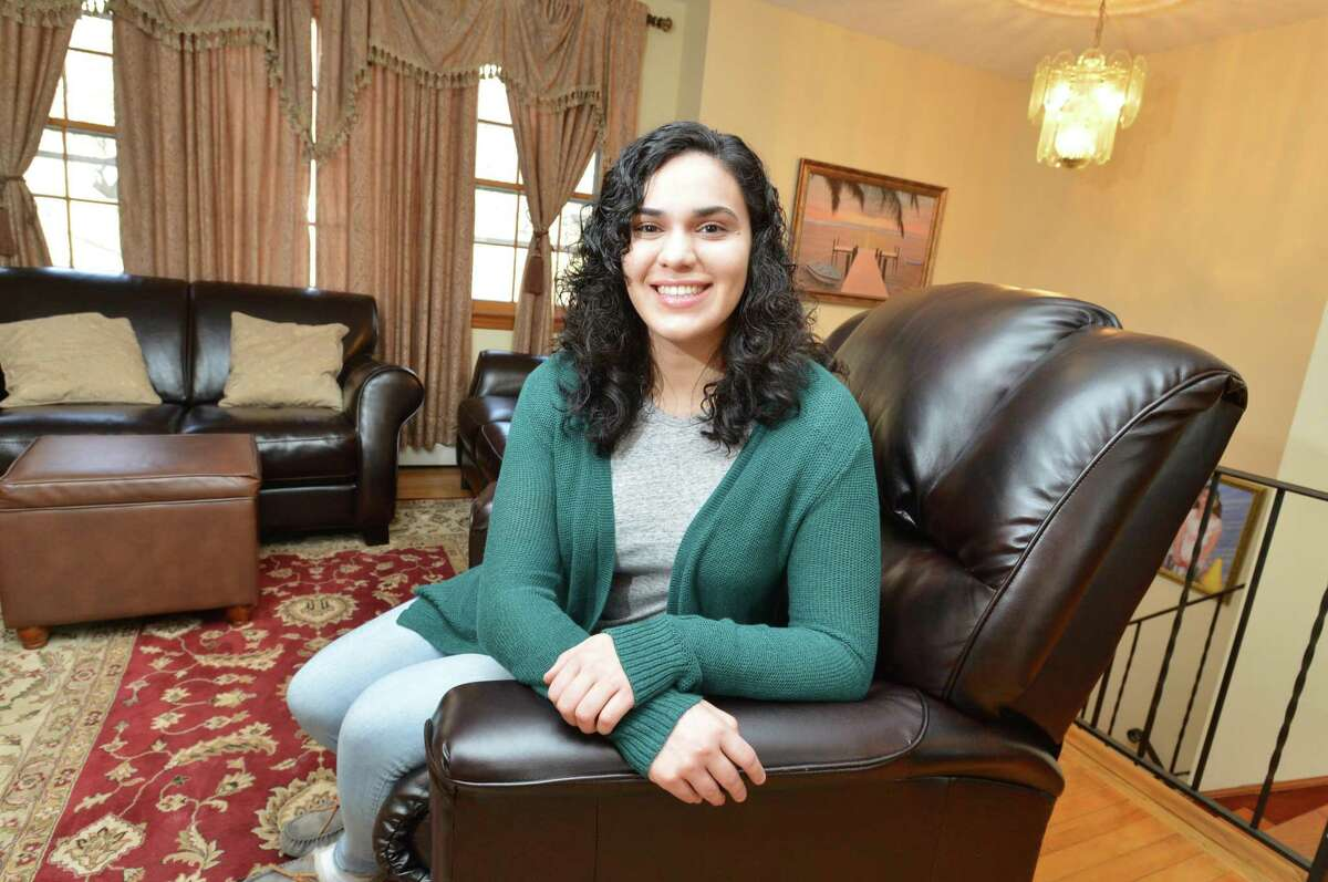 Katerina Karaiskos in the living room of her Norwalk Conn. home on Thursday April 5, 2018, she is the recipient of the 2018 Kevin M. Eidt Memorial Scholarship. The $100,000 scholarship goes to an outstanding senior at Norwalk High School, is one of several that The Kevin M. Eidt Memorial Scholarship Fund gives out.