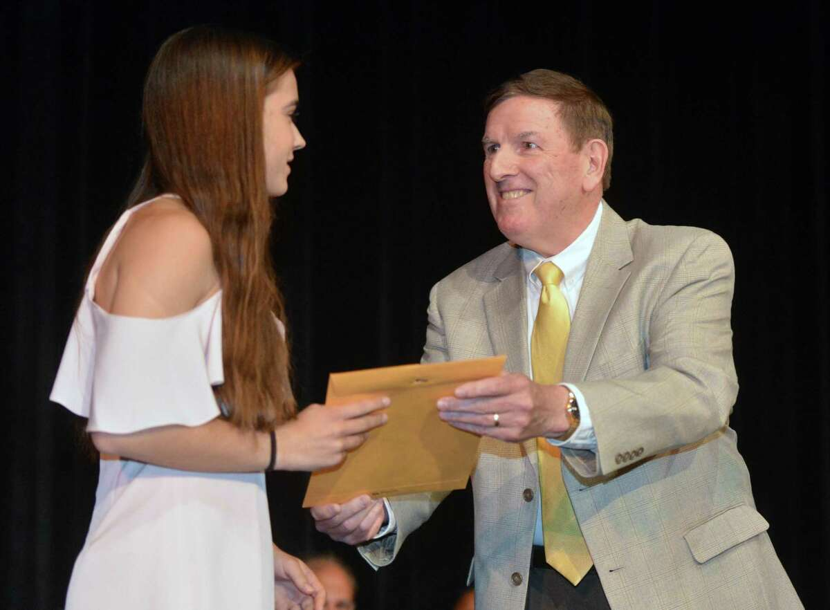 Chris Eidt presents Gracie Bradley the Kevin M. Eidt Memorial Scholarship on Wednesday May 24, 2017 in Norwalk Conn. during Norwalk High School Awards Night. The Scholarship is for a student with outsanding achievement across the spectrum of academics, athletics, arts, and community and religious service