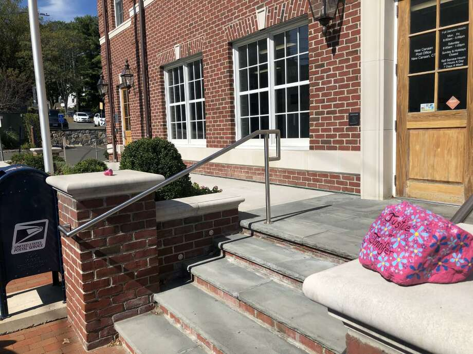 """Pictured is the bigger """"Justice for Jennifer"""" rock at the entrance to the United States Post Office in New Canaan, Connecticut, and on the right side of the steps outside of the building. A smaller rock is on the left side of the steps. Contributed photo Photo: Contributed Photo"""