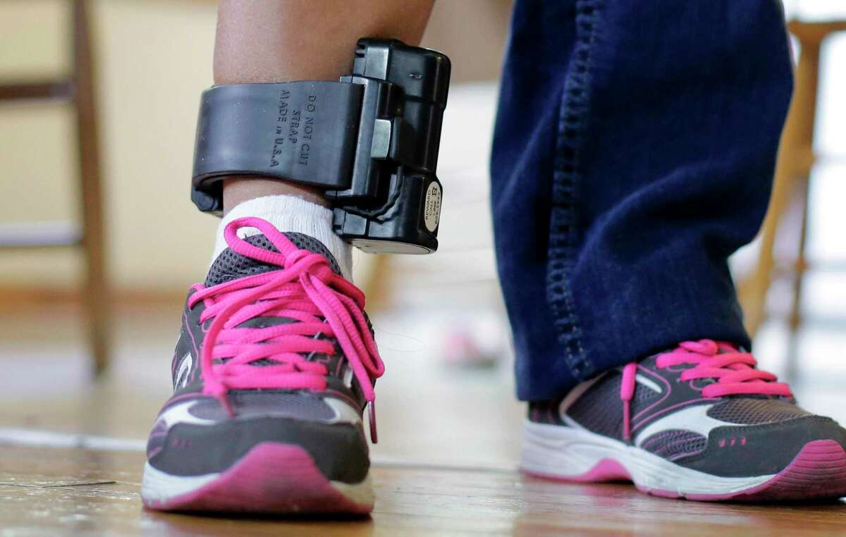 Ankle monitors are typically used as conditions of pre-trial release, probation or parole supervision. (AP Photo/Eric Gay)