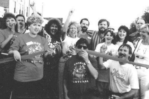 Friends of Conroe members cut the ribbon at the first Conroe Cajun Catfish Festival in November 1990. Pictured from left to right are Sandra King, Ann Crawford, Ida Lynn Willis, then Mayor Starlett Curry, Charles Tullos, Jay Ross Martin III, Leo Hewett, Kelly Carter, Shirley Hewett, Richard Willis and Barbara Metyko.
