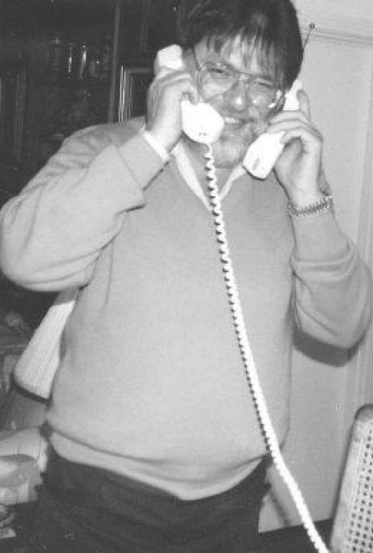 The late Jay Ross Martin III manning two phones at once while making preparations for the Conroe Cajun Catfish Festival in the festival's early years.