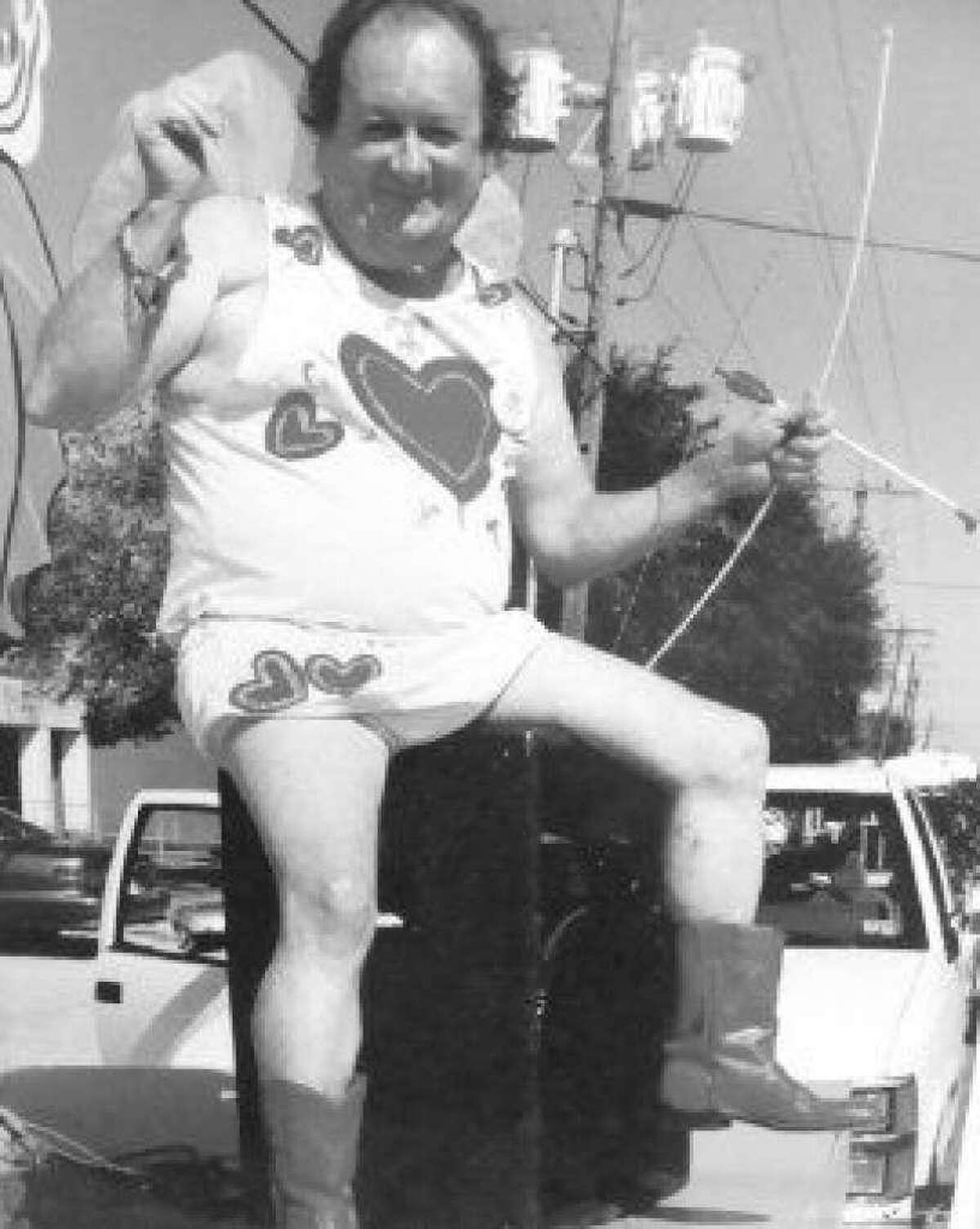 """Late Conroe businessman Wayne """"Killer"""" Vaughn dressed as cupid during a Conroe Cajun Catfish Festival parade in the festival's beginning years."""