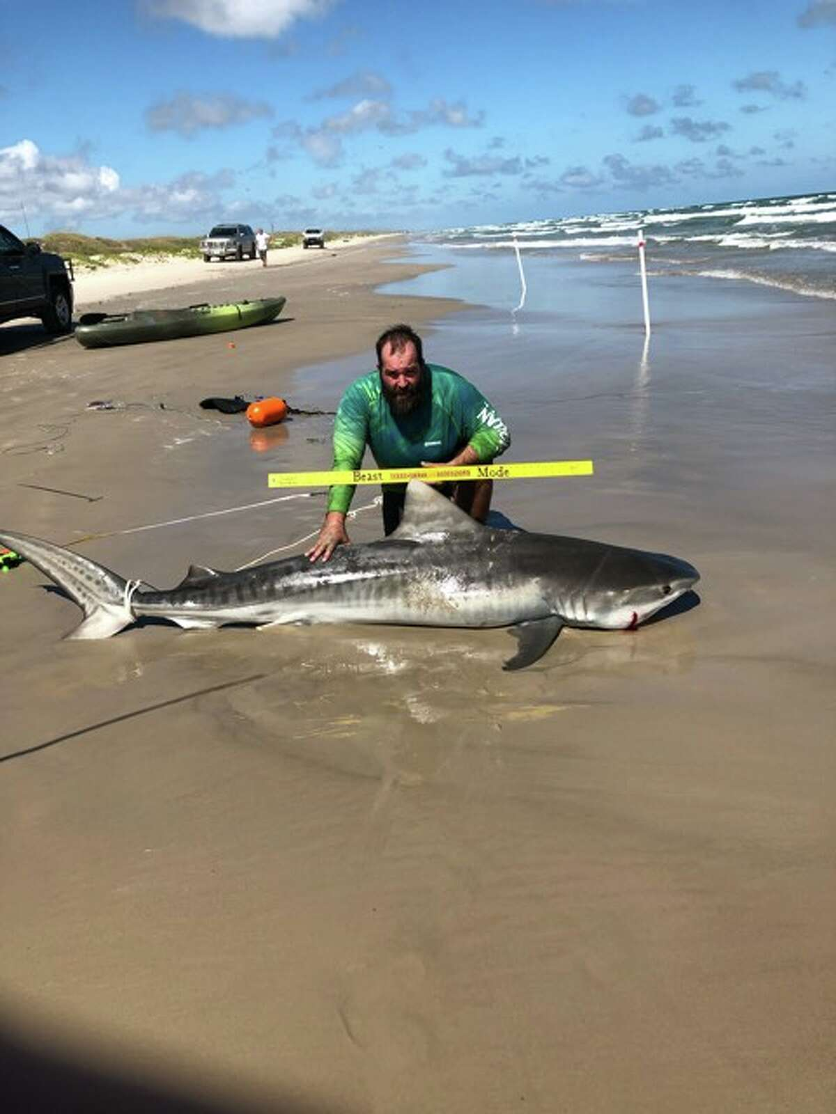 A Texas man is celebrating his personal best after he caught an 8-foot-9-inch tiger shark in Corpus Christi last weekend.