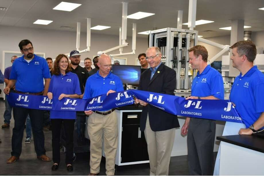 County Commissioner Robin Donnelly cut the ribbon to officially open J&L Laboratories in Midland this week. Photo: Courtesy J&L Laboratories