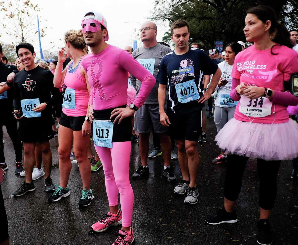 Daniel Barron, left, lines up at the Susan G. Komen Race for the Cure.