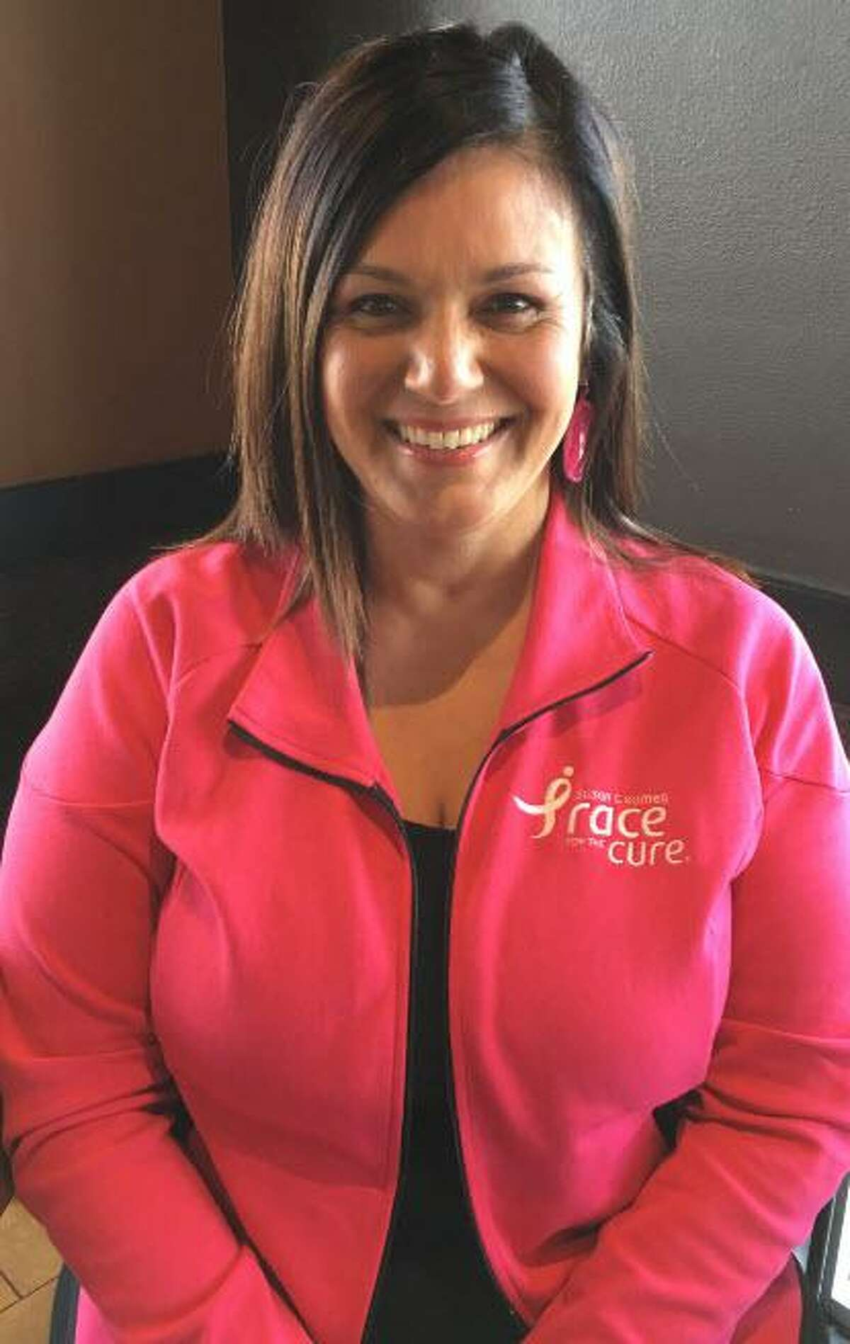 Cindy Saenz, a breast-cancer survivor, advocates for self-exams to detect breast cancer in its early stages.