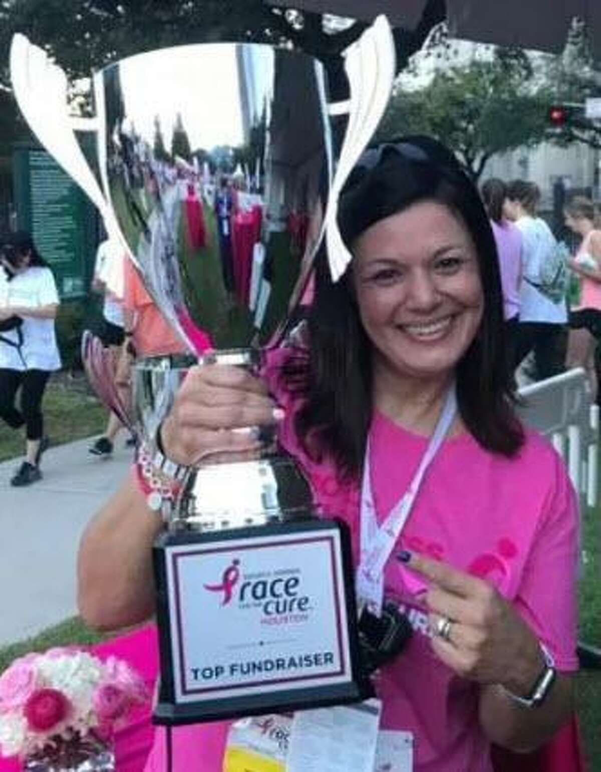 Cindy Saenz receives recognition for her fundraising on behalf of the Susan G. Komen Race for the Cure Houston.