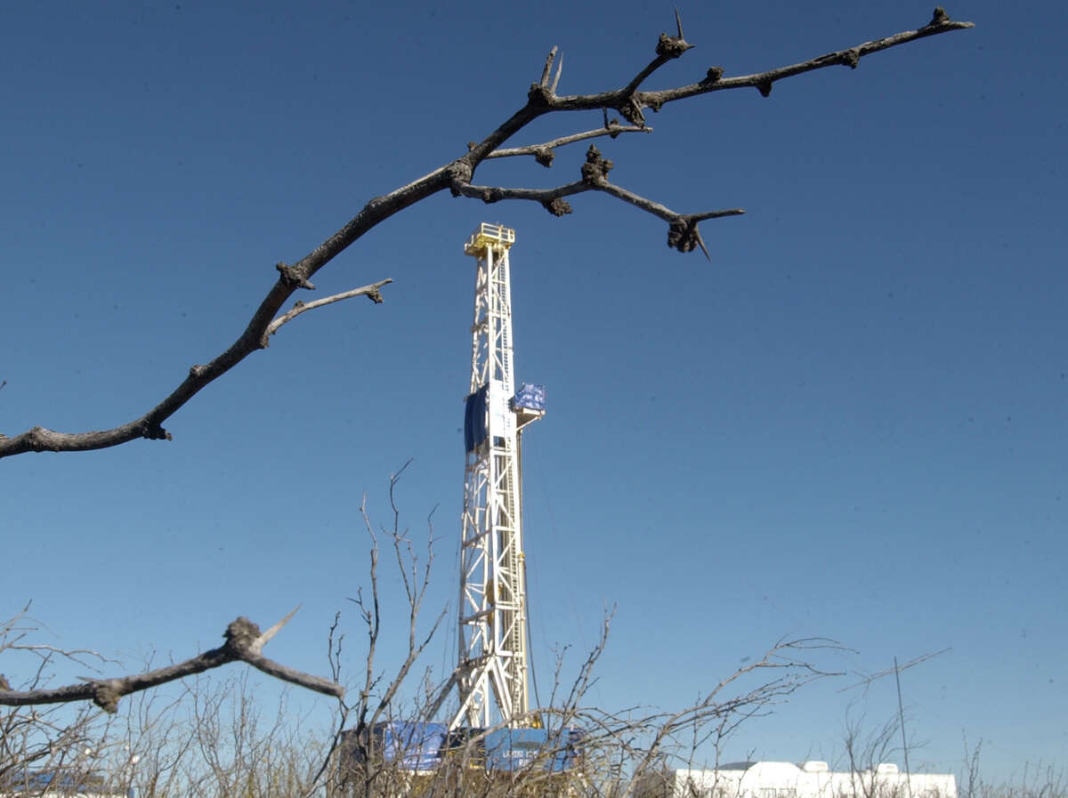 """12/14/04--Lariat Well #9 drills for oil in Upton County, Texas in the Midland Odessa area. The derrick is one of the older style """"Jackknife"""" derricks. It is larger than the newer """"Super Singles"""" derricks, which can be moved easier and less expensively. Photo by Steve Campbell"""